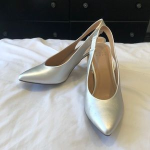 Retro-style pointed sling back pumps.